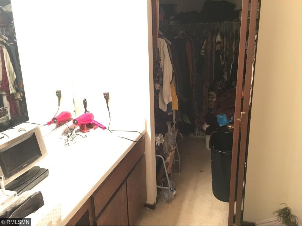 Walk-in-closet and master vanity.