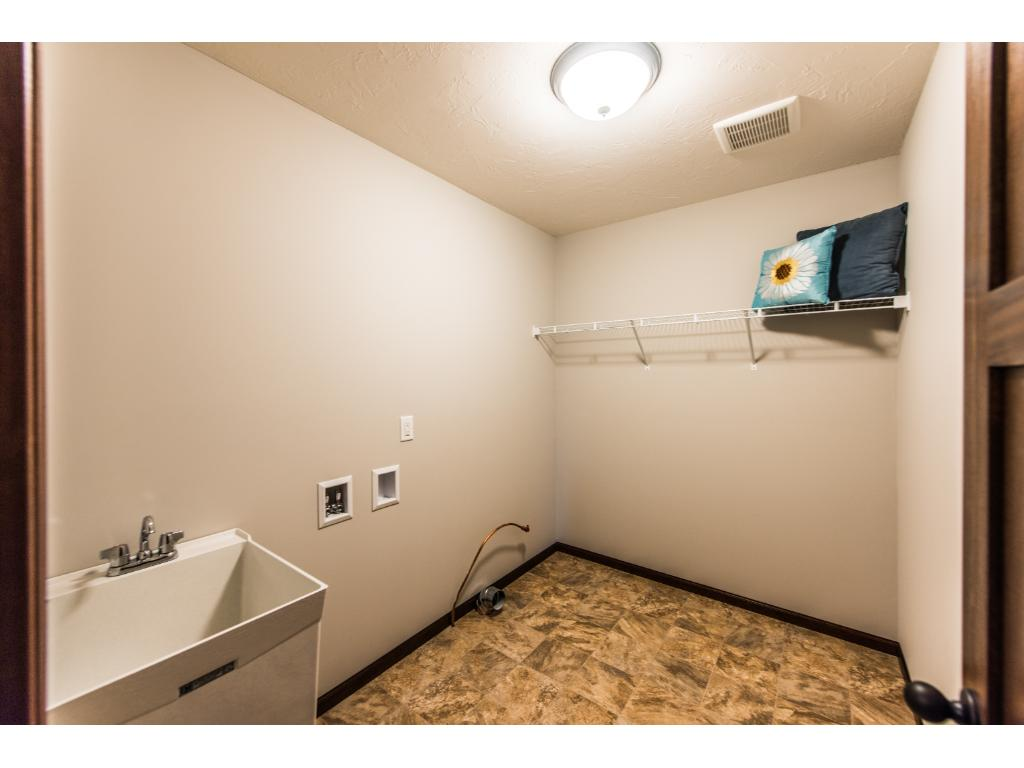 Laundry room is conveniently located upstairs next to bedrooms