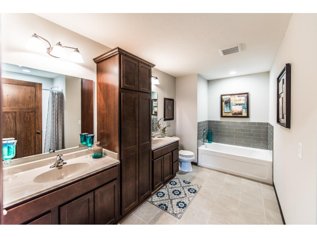 Large master bath features two sinks, soaking tub and separate shower