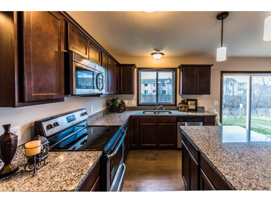 Beautiful kitchen featuring granite counters, rich maple cabinets and ss appliances