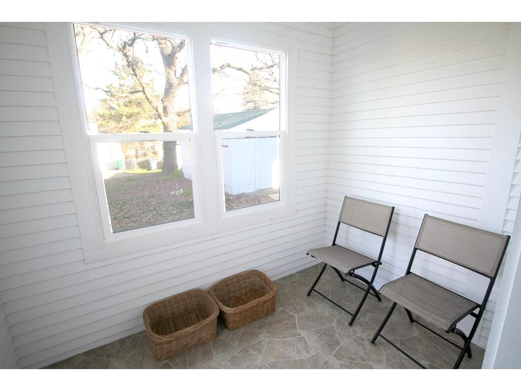Main level mud room/porch. Easy access from garage. Door into kitchen to drop groceries and shoes.
