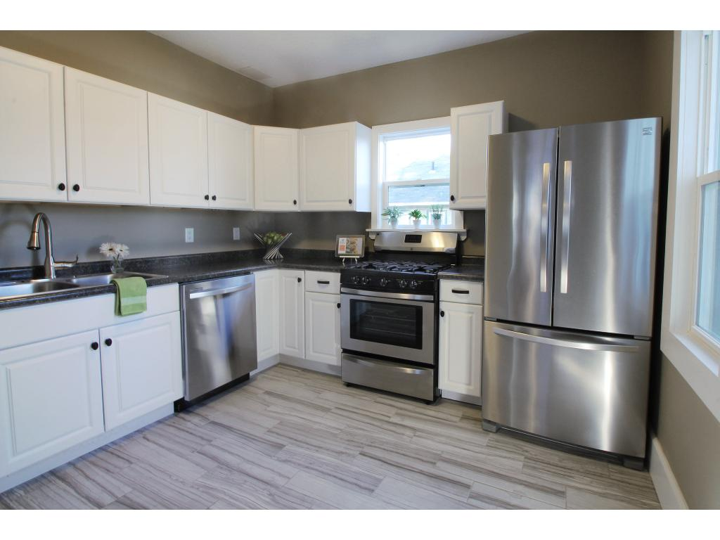 Completely new kitchen - tile, enameled cabinetry, and stainless steel appliances.