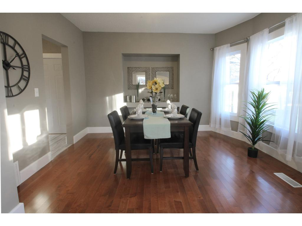 Nice size dining room with lots of light. Open to kitchen and living room. New flooring and paint.