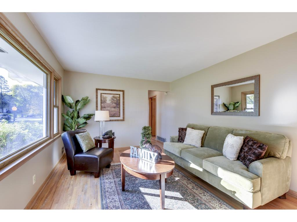 The front living room includes hardwood floors and a large picture window.