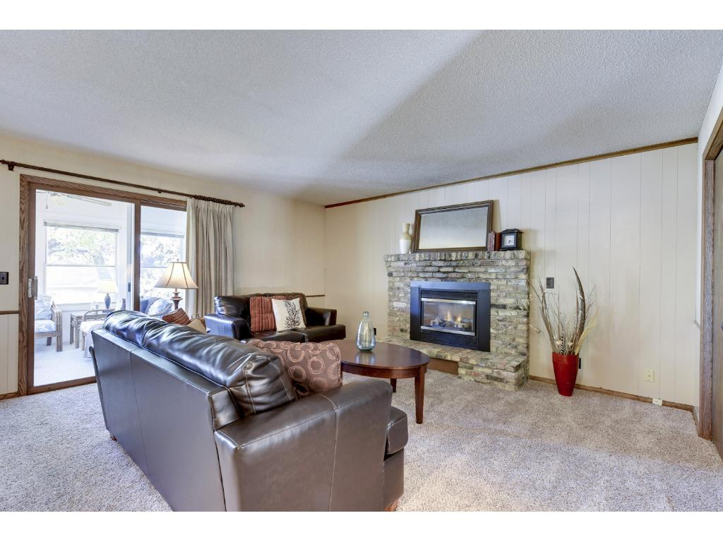 The main level family room with gas fireplace is a nice addition to the home.