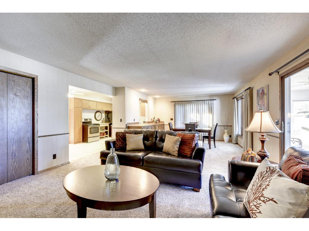 The main level family room also boasts a large closet for storage. View of the family room, kitchen and Dining room.