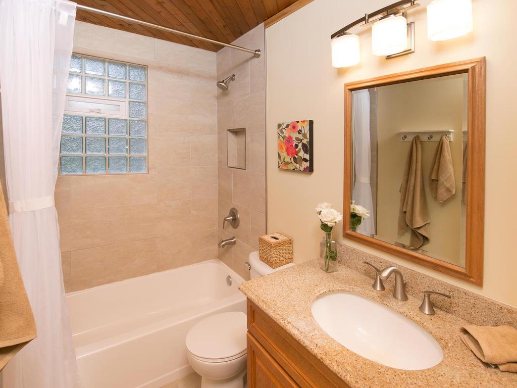 Updated main floor bath with glass block window, granite & tile