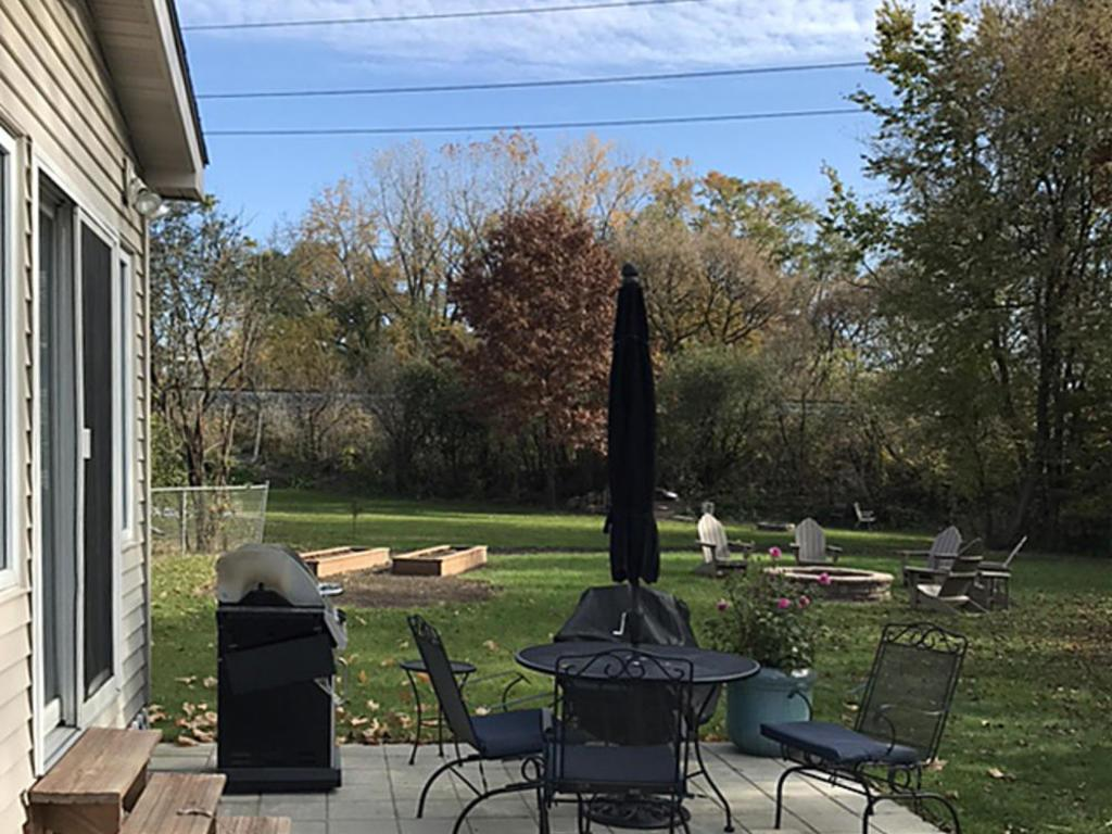 Paver patio outside sunroom is great for entertaining
