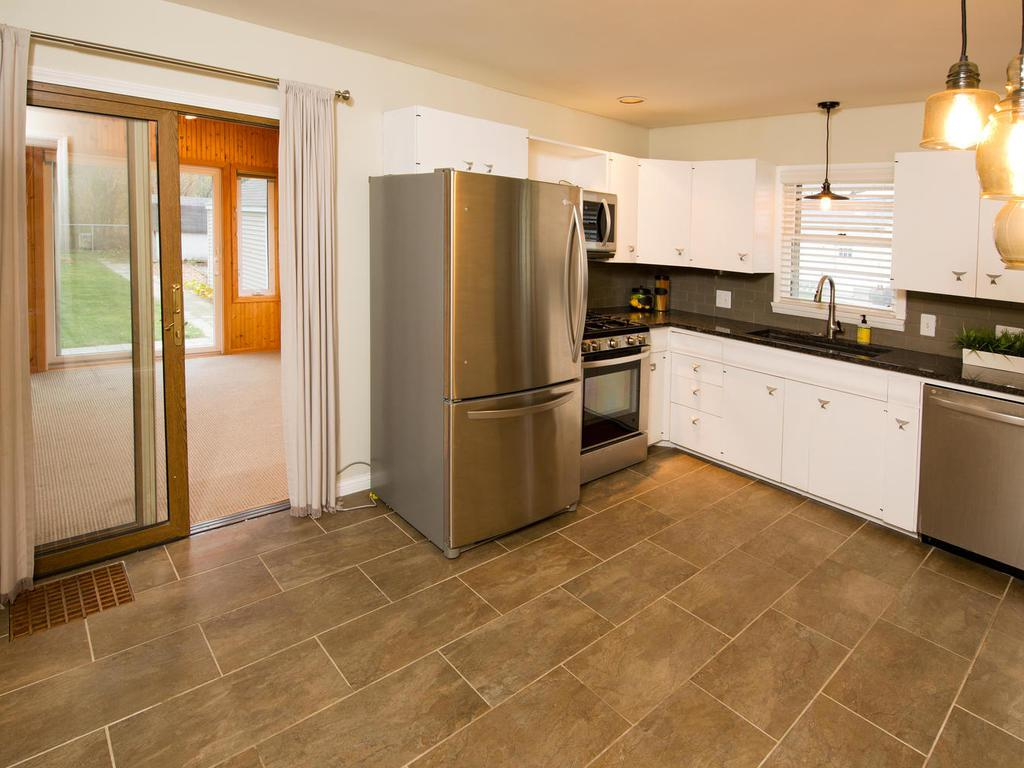 Updated kitchen with newer appliances & tile flooring