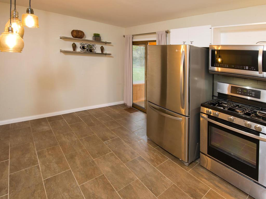 Spacious eat in kitchen opens to sun room