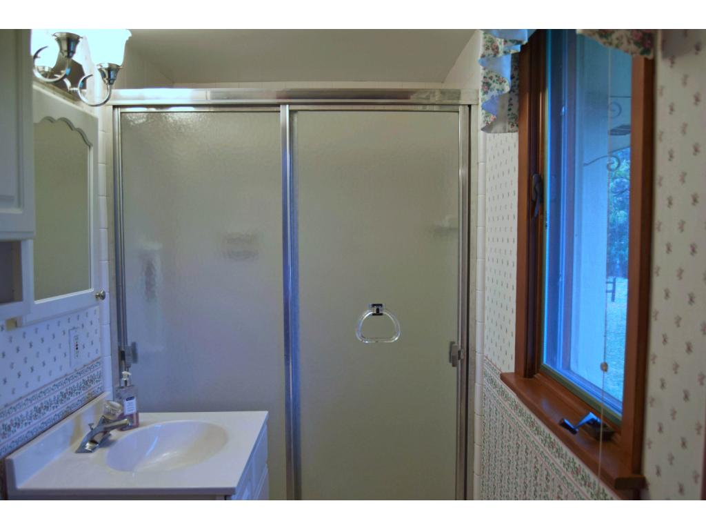 Unusual in a home this vintage to have a master bathroom! 3/4 bath, with daylight window. Both of the bathrooms have tile floors.