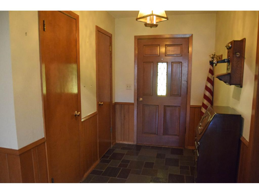 Large foyer, with two coat closets -- one is extra deep for convenient storage.