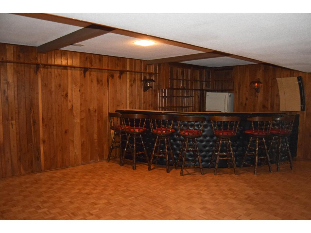 The lower level is huge, and includes this built-in bar area. The rest of this side of the lower level is perfect for a game room -- plenty of space!