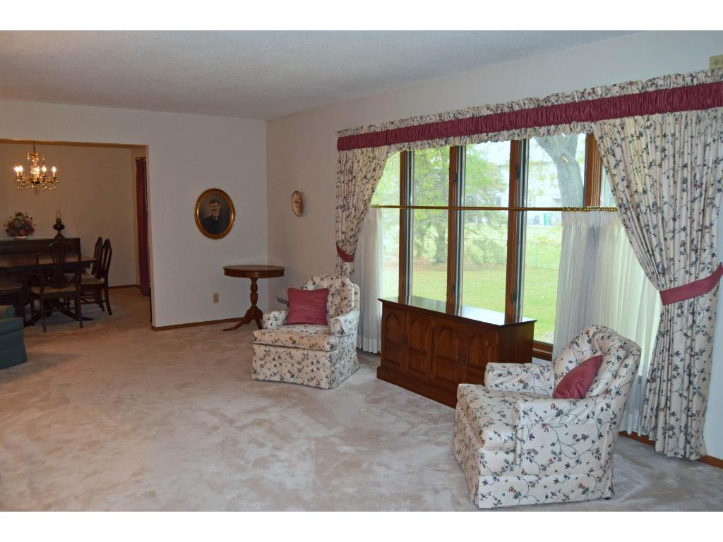 Spacious living room has huge bank of windows overlooking the back yard. Open to formal dining room.