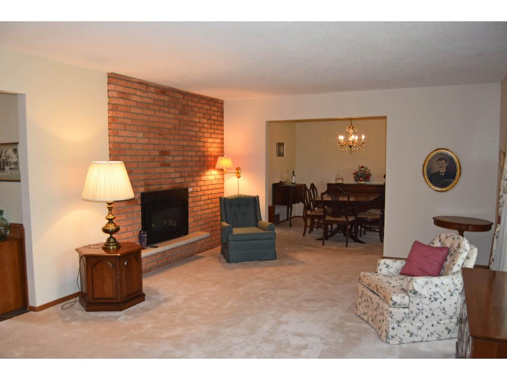 The living room includes this floor-to-ceiling brick fireplace. There is another brick fireplace on the other side of this wall, in the informal dining area.