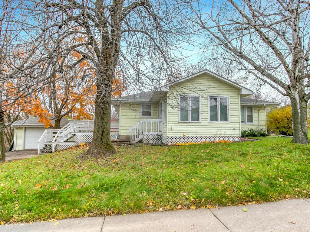 Charming home with wooded lot next to it included!