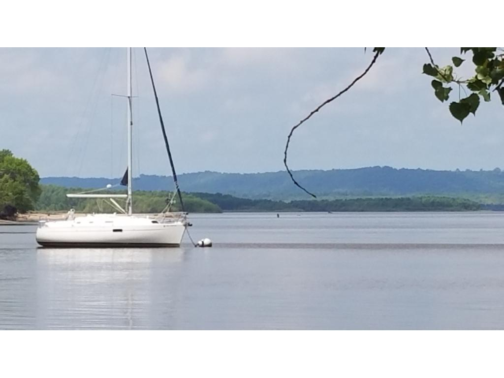 Depending on the stage of the river, it may be only 40 feet to your sailboat. A sturdy dock would get a cabin cruiser in.