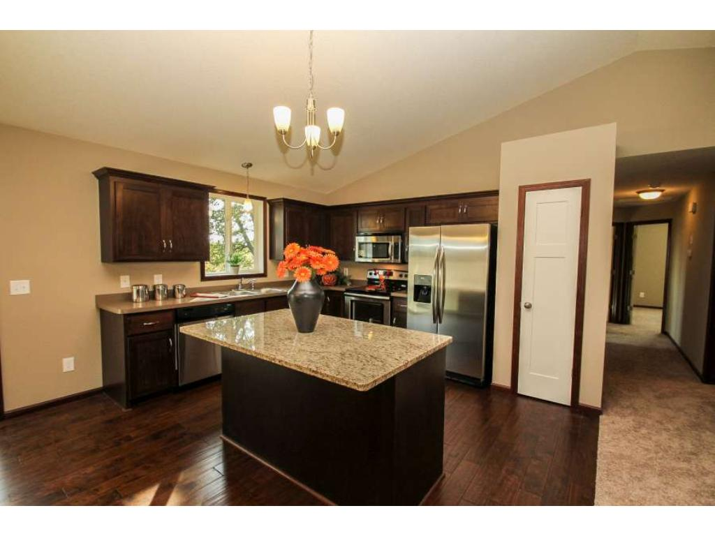 Kitchen with Stainless Steel Appliance Package and Pantry