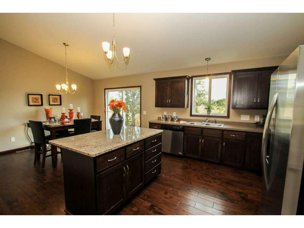 Beautiful Tennessee Whiskey Flooring Throughout Kitchen and Dining Area