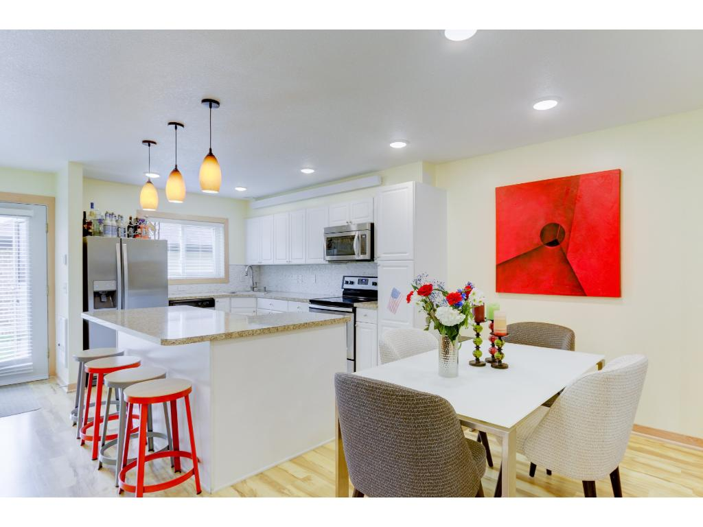 Completely remodeled kitchen. New stainless appliances, counter tops, backspalsh, cabinets & flooring