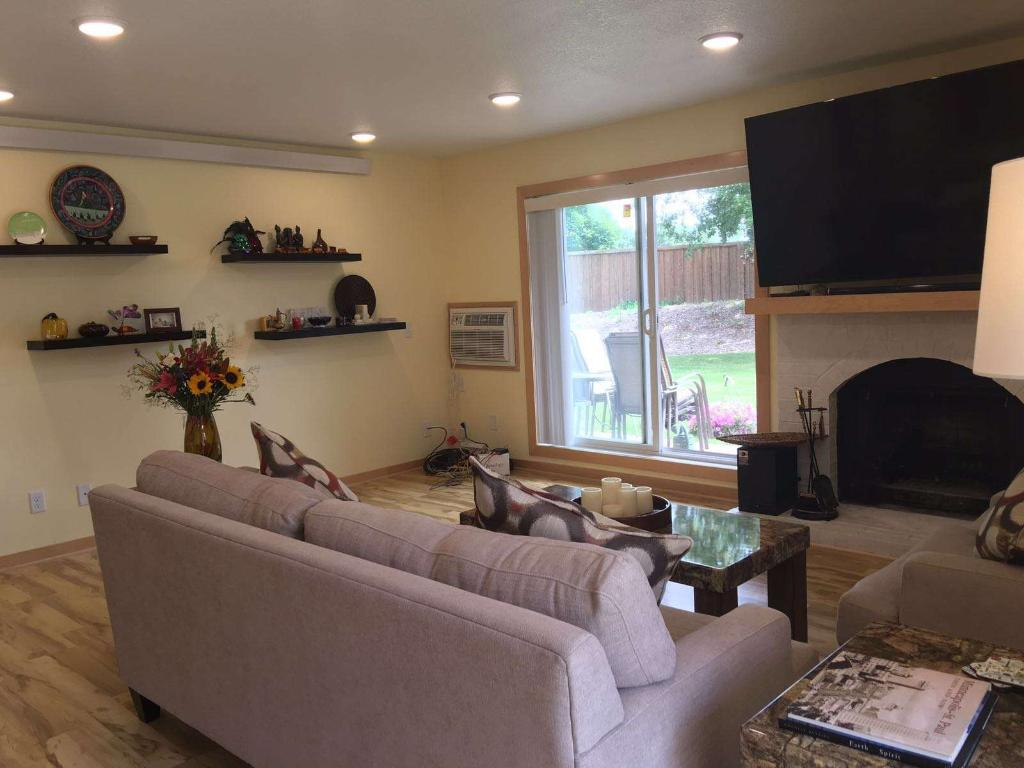 Living room with fireplace and walkout to patio