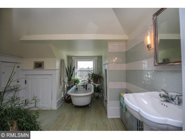 Upper master bedroom suite with private bathroom.
