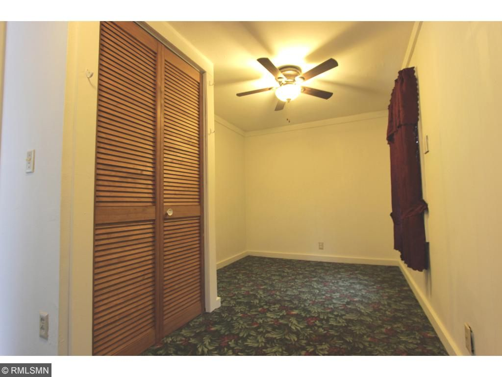 Main Level Bedroom has Ceiling Fan and Patio Door