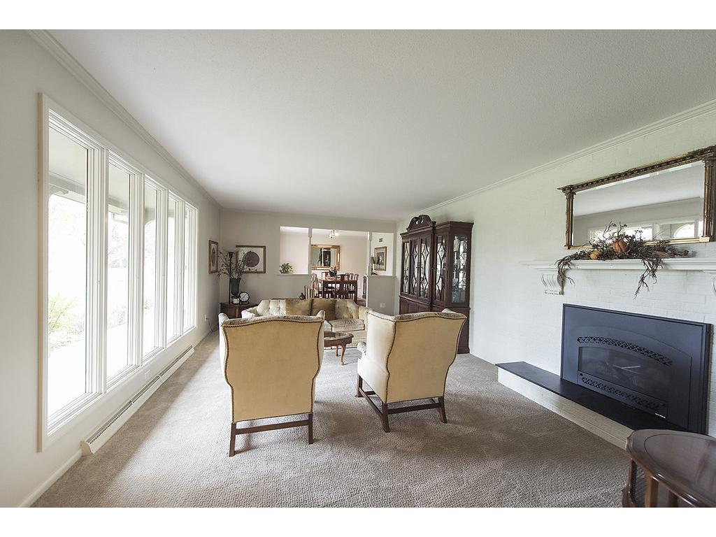 One of the 3 common areas - use this as another living room or family room, gas fireplace, plenty of space, numerous windows and comfortable to boot!