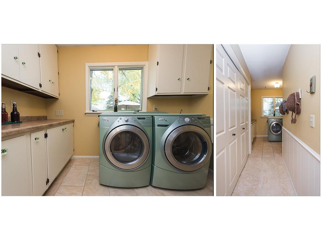 Main floor laundry is remarkable - front load washer and dryer, countertop space, storage, cupboards and views of the backyard!