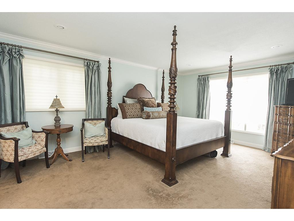Gorgeous master suite with private master bath - plenty of room, on the main level and beautiful windows.