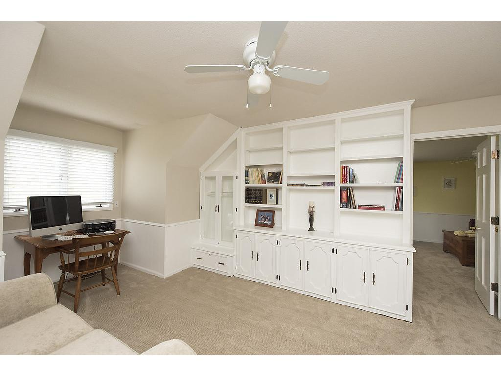 Check out this office!  Window, storage, great built in bookcases, ceiling fan, comfortable and spacious!