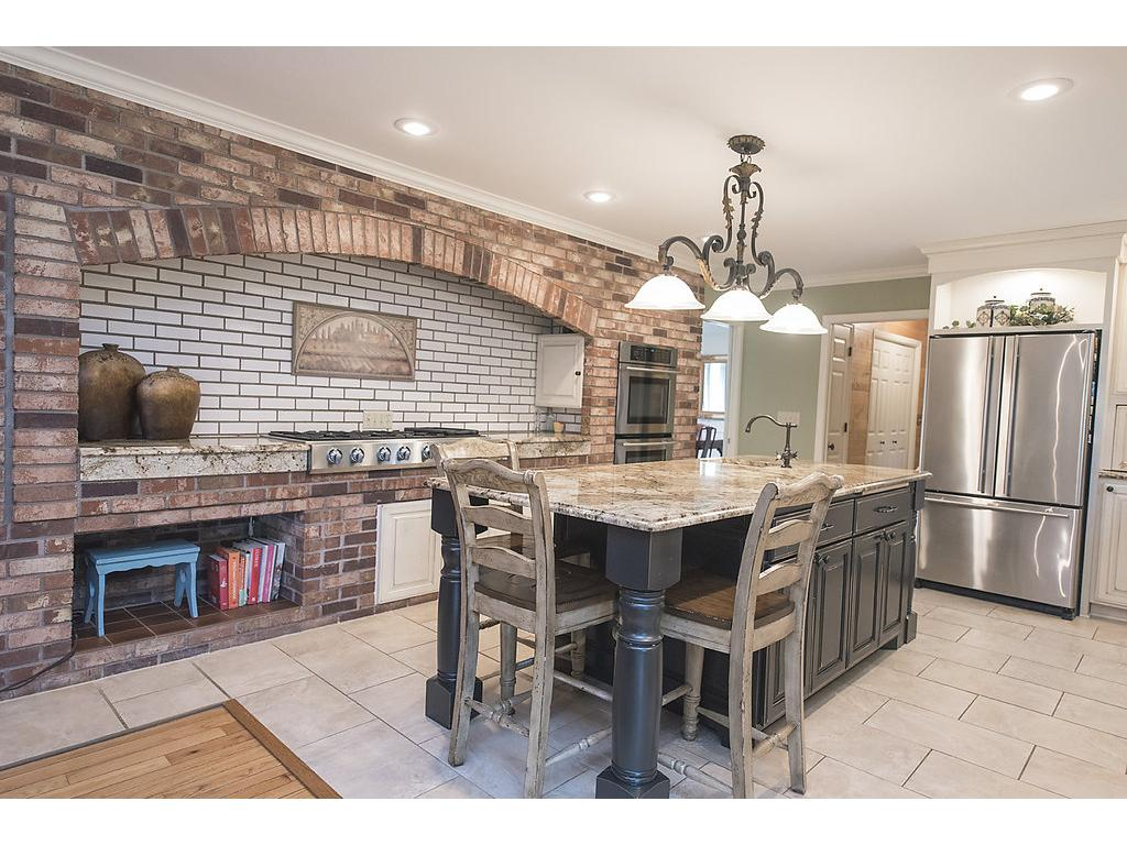 Check out the size of this gourmet kitchen!  Fit for a professional chef, tons of natural light, SS appliances - double oven and you'll love the cooktop!