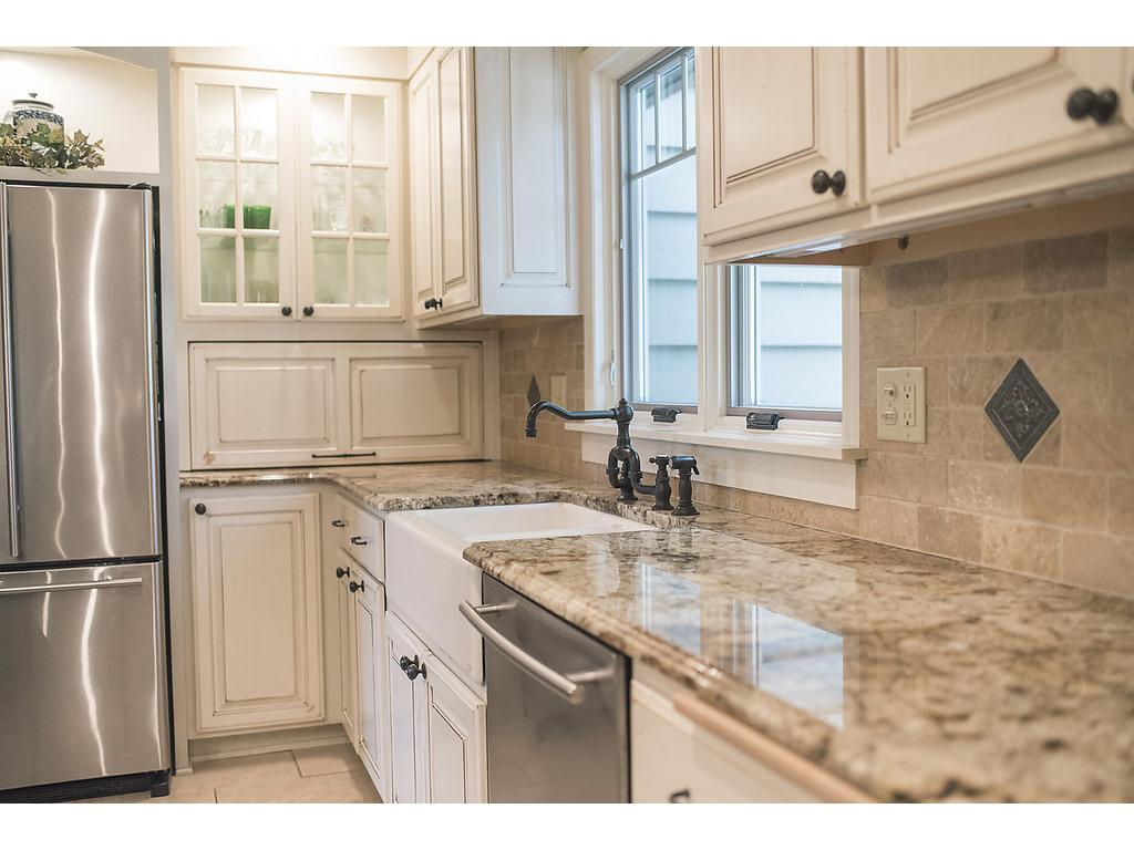 Notice the custom tiled backsplash, numerous cabinets and character of this one of a kind kitchen!