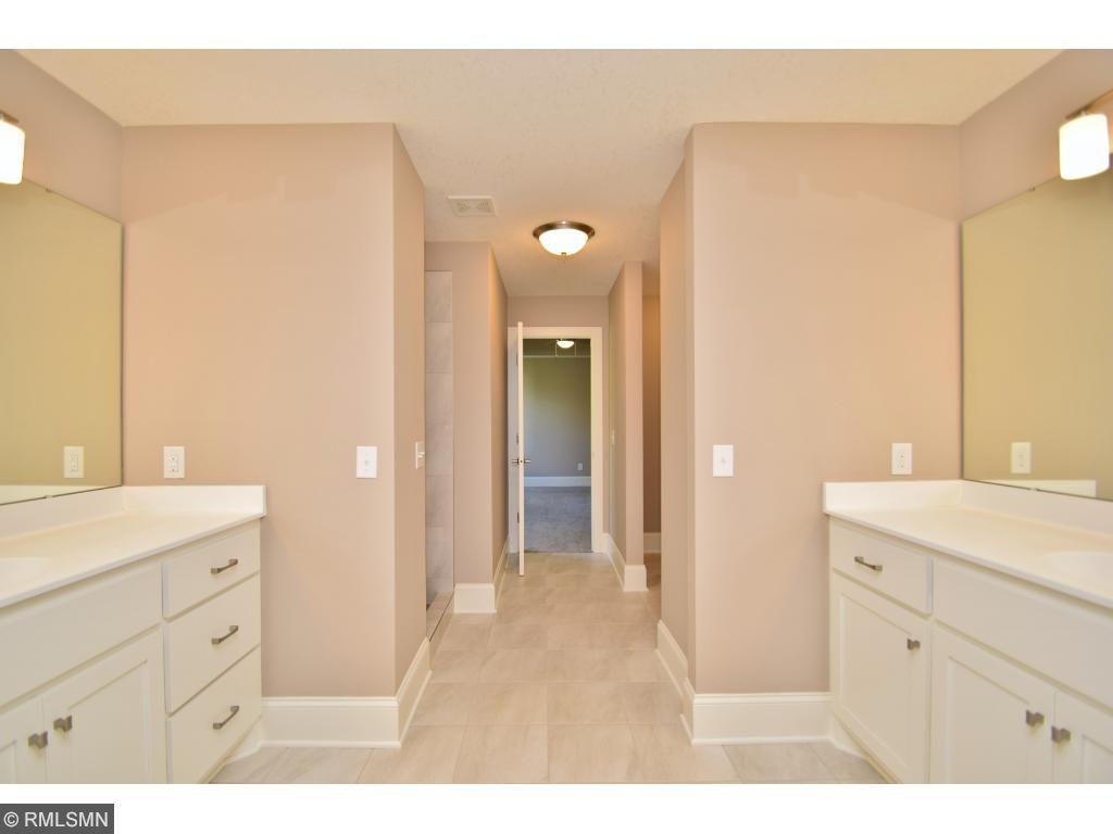 Dual vanity private owners bath w/custom enameled cabinets!
