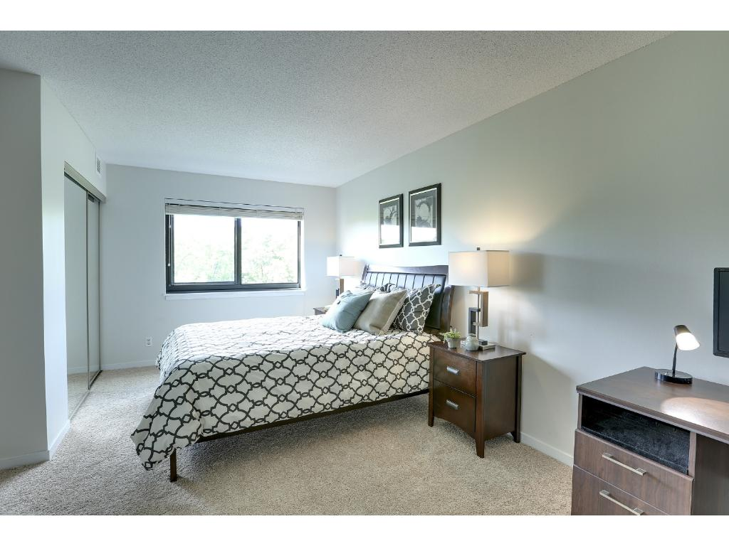 The bedroom, like the rest of the unit, has great natural light.