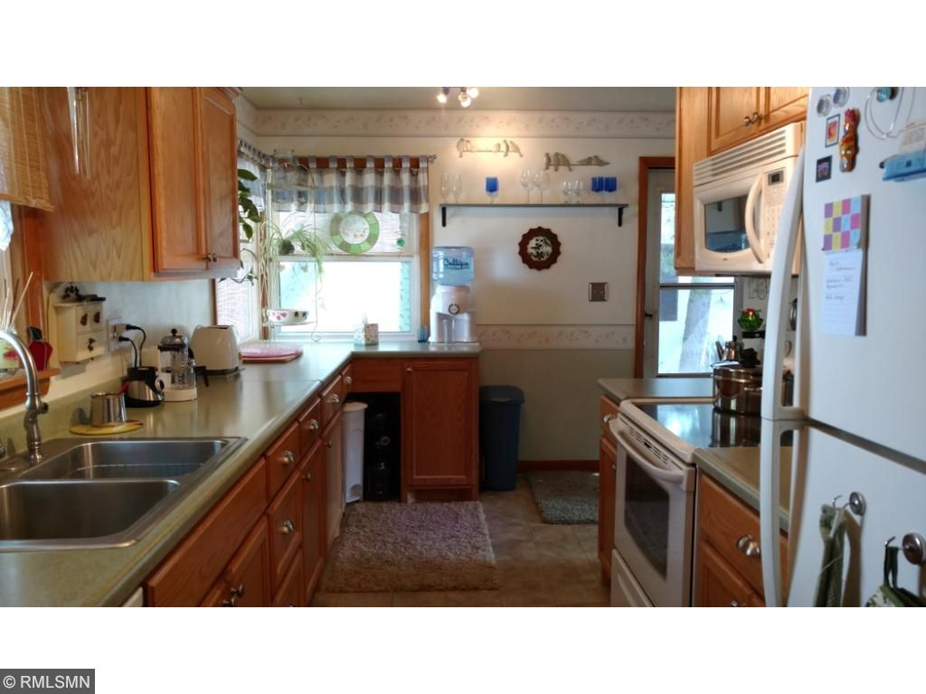 Large kitchen has many cabinets and lots of counter space.