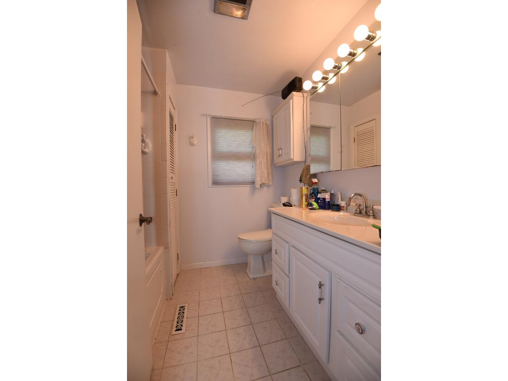 Spacious full bath with large shower/tub which includes whirlpool jets.