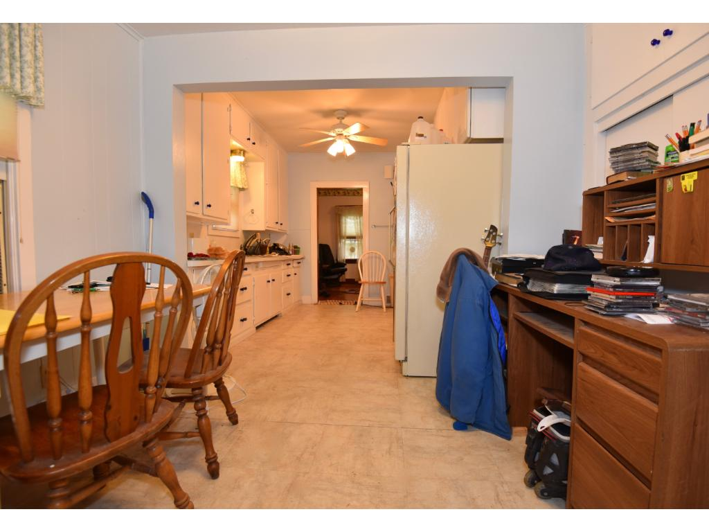 View looking through dining area and into kitchen area of home. Taken from main entrance mud/laundry room area.