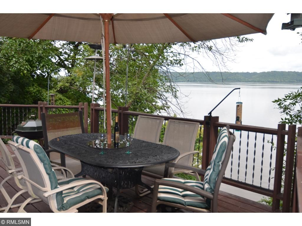 Enjoy sunny days on the spacious deck overlooking the lake.
