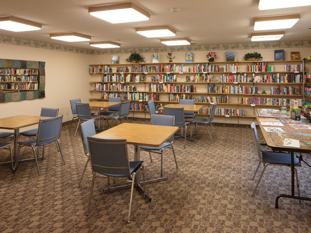 On the garage level you will find a library and game room as well as a workshop that is loaded with tools!