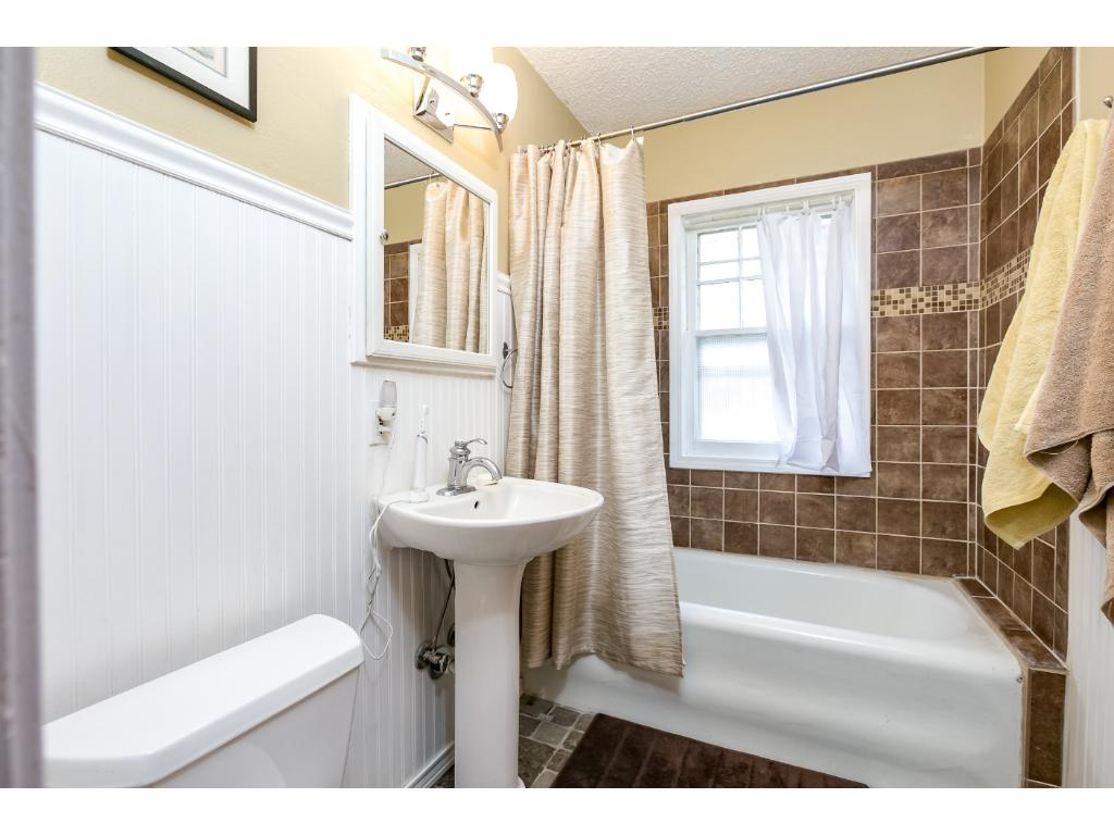 Upper level bathroom has been nicely remodeled with a heated floor!
