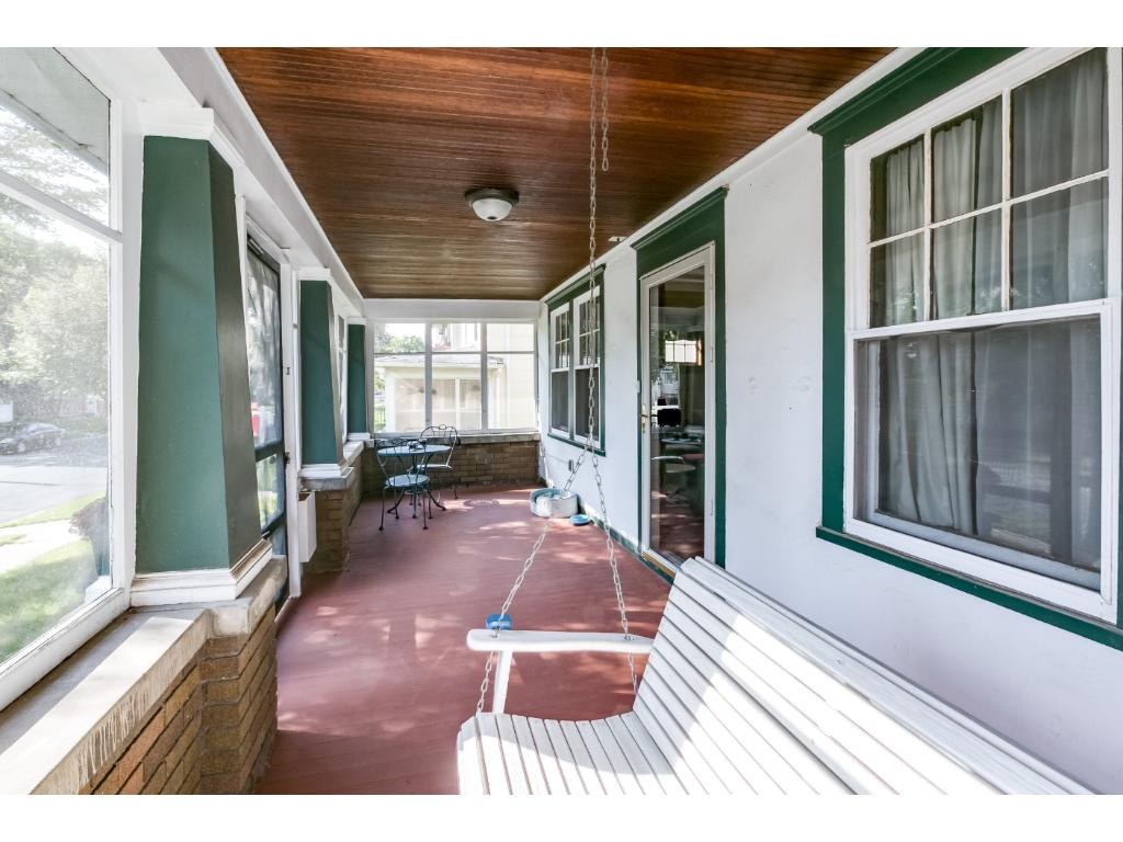Charming porch perfect for that first cup of coffee!