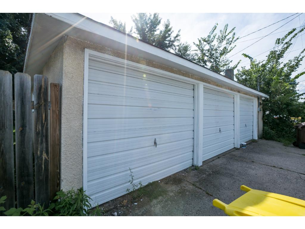 """Comes with a """"man cave!"""" This three car garage comes with a lift and new electric!"""