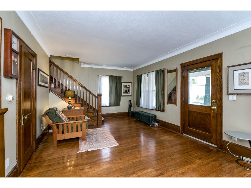 Gleaming hardwood floors, built-ins, with tons of natural sunlight beaming through and through!
