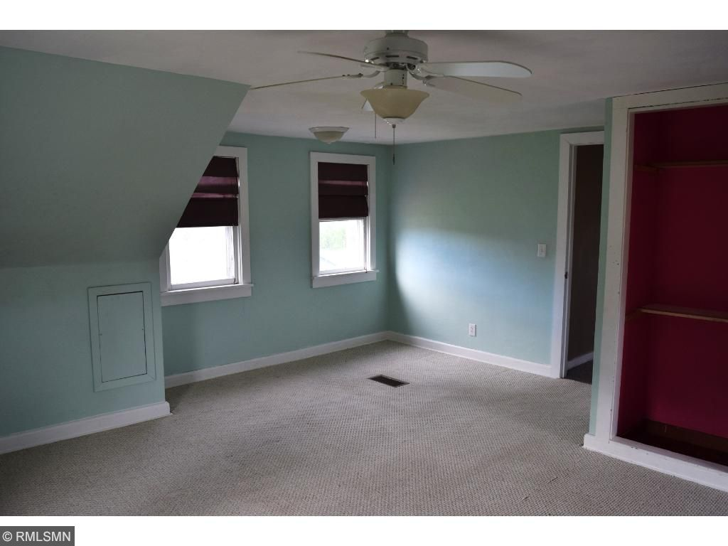 The master bedroom upstairs is roomy and offers a great view of your 10 acres with all its amenities.