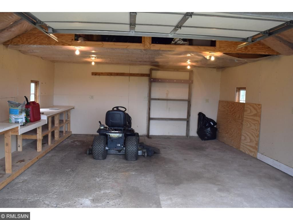 A clean garage with plenty of room for your handyman skills.