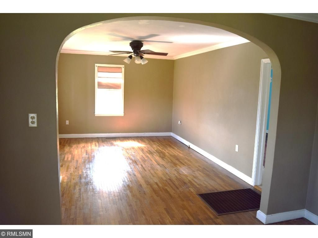 a beautiful arched entry way, separating the dining and living room.