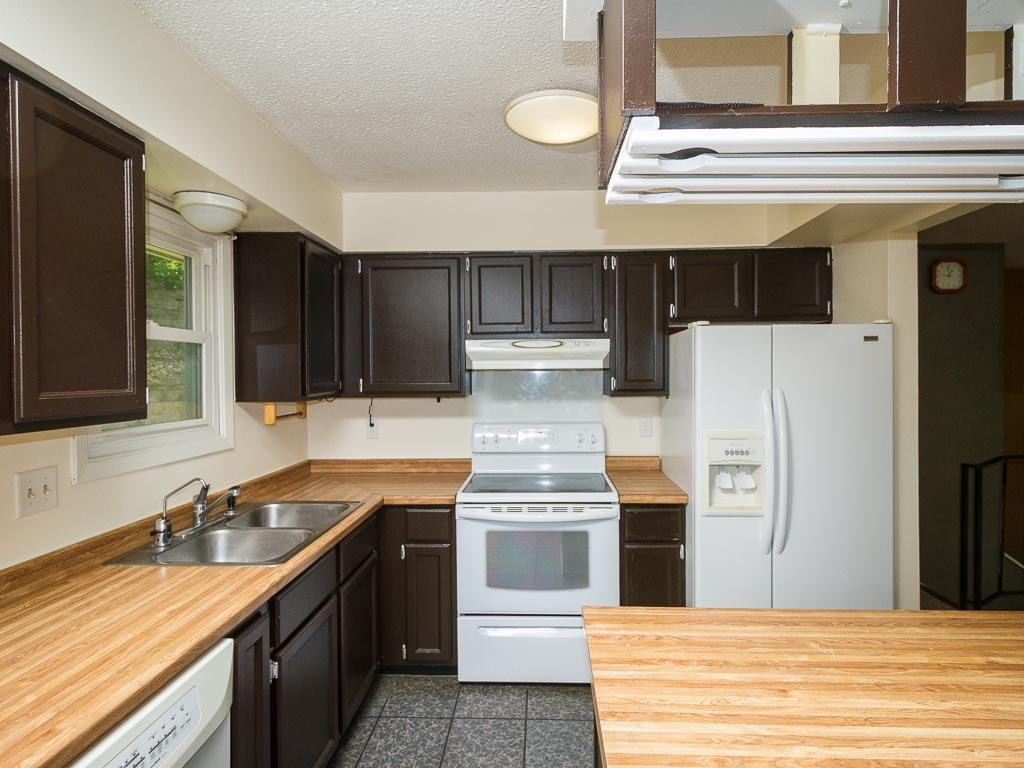 The kitchen has loads of cabinets and counter space.