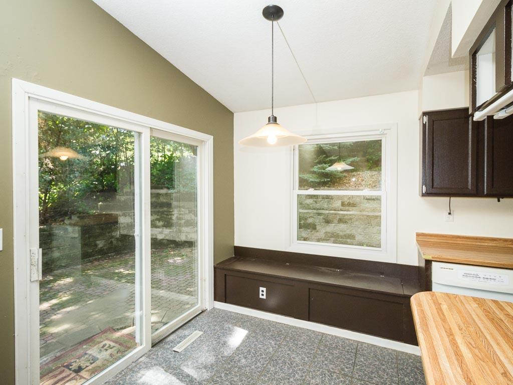The dining area has additional storage inside the window seat. You'll love walking out to the patio from this bright room!