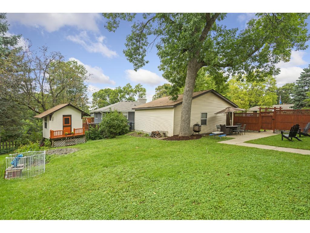 Large, private back yard. Charming storage shed converted from kids' playhouse.